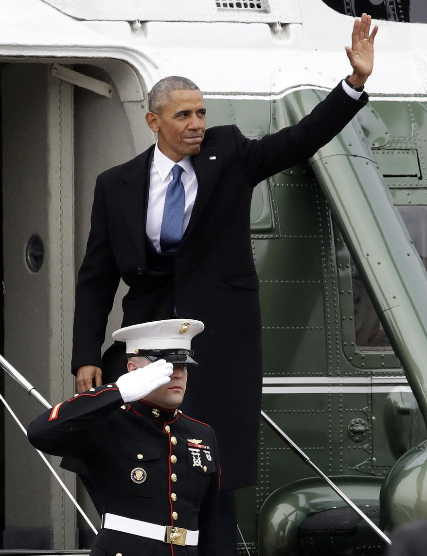 Former president Barack Obama waves as he boards a Marine helicopter on the East Front of the Capitol, Friday, Jan. 20, 2017, in Washington, after Donald Trump was inaugurated. (AP Photo/Evan Vucci)