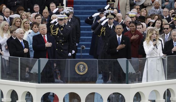 President Donald Trump and Vice President Mike Pence listen to the National Anthem sung by Jackie Evancho with former President Barack Obama and his wife Michelle during the 58th Presidential Inauguration at the U.S. Capitol in Washington, Friday, Jan. 20, 2017. (AP Photo/Patrick Semansky)