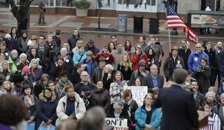 A crowd listens as Indianapolis Mayor Joe Hogsett speaks during an inclusion rally Friday, Jan. 20, 2017, in Indianapolis. (AP Photo/Darron Cummings)