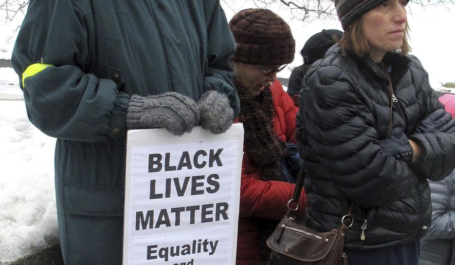 "Ann Burcroff holds a ""Black Lives Matter"" sign at an ""Un-augural Rally"" protest Friday, Jan. 20, 2017, in Montpelier, Vt., to protest the inauguration of President Donald Trump in Washington. About 100 activists gathered on the steps of the Vermont Statehouse to protest. (AP Photo/Wilson Ring)"