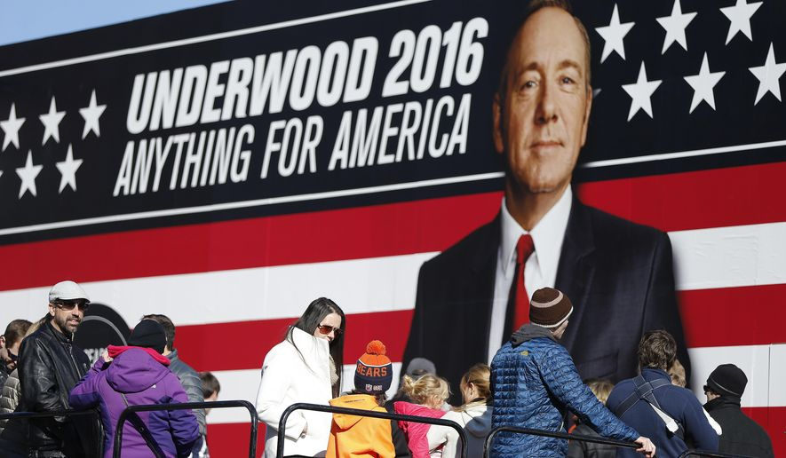 """FILE- In this Feb. 13, 2016 file photo, people stand in line waiting to enter the Underwood 2016 booth ahead of the CBS News Republican presidential debate in Greenville, S.C. Netflix announced on Jan. 20, 2017, that political drama """"House of Cards"""" will return this May for a fifth season. (AP Photo/John Bazemore, File)"""