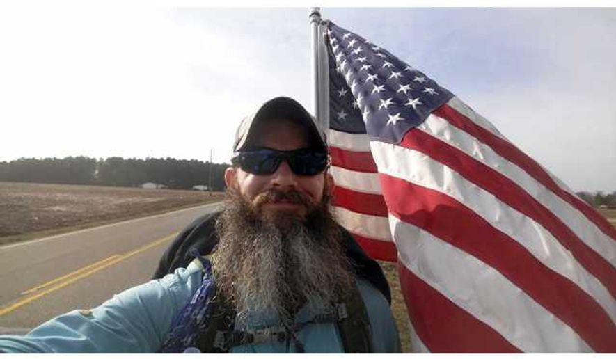 U.S. Marine Shane Stephens is hiking 22 miles each day to raise PTSD awareness. It is estimated that 22 military veterans a day commit suicide due to post traumatic stress disorder. (Photo: Gainesville [Ga.] Times) [http://www.gainesvilletimes.com/section/6/article/121436/]