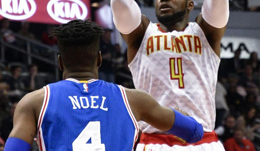Atlanta Hawks forward Paul Millsap (4) shoots as Philadelphia 76ers forward Nerlens Noel (4) defends during the first half of an NBA basketball game, Saturday, Jan. 21, 2017, in Atlanta. (AP Photo/John Amis)