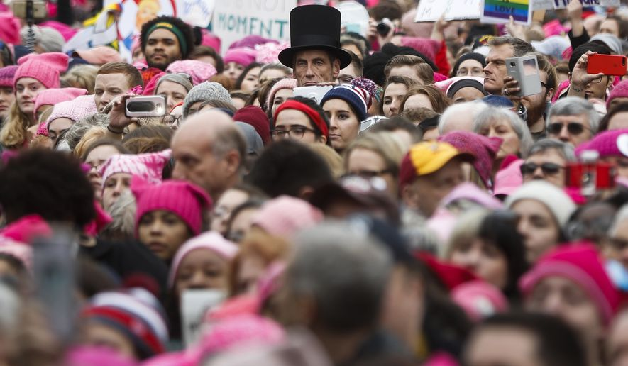 A man dressed as Abraham Lincoln stands with protestors at the Women's March on Washington during the first full day of Donald Trump's presidency, Saturday, Jan. 21, 2017 in Washington. Organizers of the Women's March on Washington expect more than 200,000 people to attend the gathering. Other protests are expected in other U.S. cities. (AP Photo/John Minchillo)