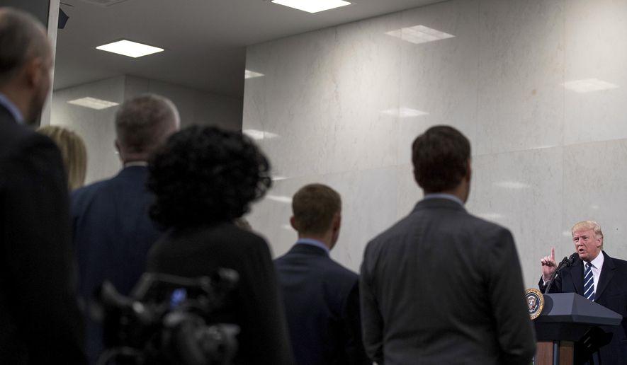 President Donald Trump speaks at the Central Intelligence Agency in Langley, Va., Saturday, Jan. 21, 2017. (AP Photo/Andrew Harnik)
