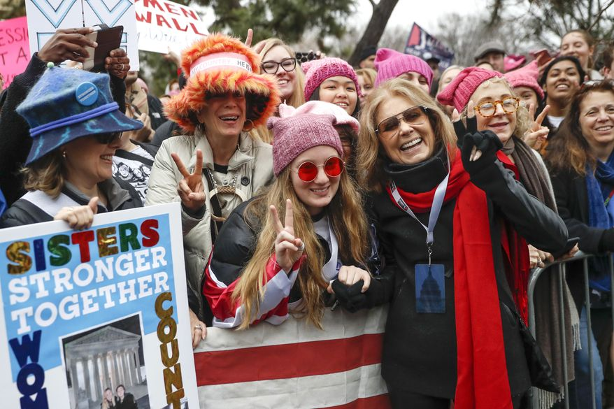 Gloria Steinem, center right, greets protesters at the barricades before speaking at the Women's March on Washington during the first full day of Donald Trump's presidency, Saturday, Jan. 21, 2017 in Washington.  (AP Photo/John Minchillo)