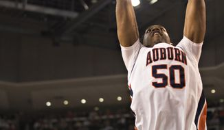 Auburn's Austin Wiley (50) dunks during an NCAA college basketball game against Alabama on Saturday, Jan. 21, 2017,  in Auburn, Ala. (Albert Cesare/The Montgomery Advertiser via AP)