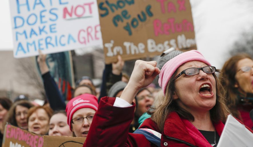 Protesters cheer at the Women's March on Washington during the first full day of Donald Trump's presidency, Saturday, Jan. 21, 2017 in Washington. (AP Photo/John Minchillo)