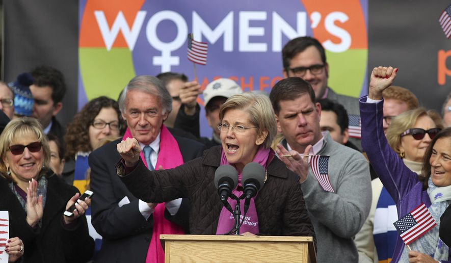 Sen Elizabeth Warren addresses the crowd as she is flanked by Se. Ed Markey, left, and Boston Mayor Marty Walsh during a Women's March Saturday Jan. 21, 2017 in Boston. The march is being held in solidarity with similar events taking place in Washington and around the nation.    ( John Tlumacki/The Boston Globe via AP)