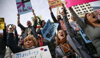 Thousands attend the Women's March Indianapolis rally, a sister rally of the Women's March on Washington, on the west side of the Indiana Statehouse in Indianapolis on Saturday, Jan. 21, 2017. (Mykal McEldowney/The Indianapolis Star via AP)