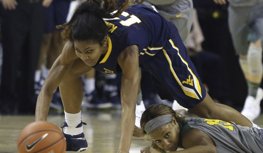 West Virginia forward Kristina King (13) and Baylor forward Nina Davis (13) vie for a loose ball in the first half of an NCAA college basketball game, Saturday, Jan. 21, 2017, in Waco, Texas. (AP Photo/Jerry Larson)
