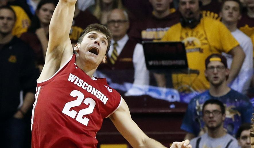 Wisconsin's Ethan Happ dunks against Minnesota during the second half of an NCAA college basketball game Saturday, Jan. 21, 2017, in Minneapolis. (AP Photo/Jim Mone)