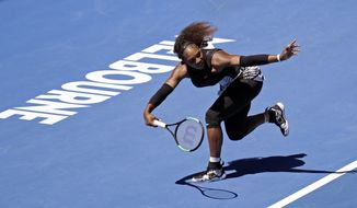 United States' Serena Williams follows through on a shot to compatriot Nicole Gibbs during their third round match at the Australian Open tennis championships in Melbourne, Australia, Saturday, Jan. 21, 2017. (AP Photo/Aaron Favila)