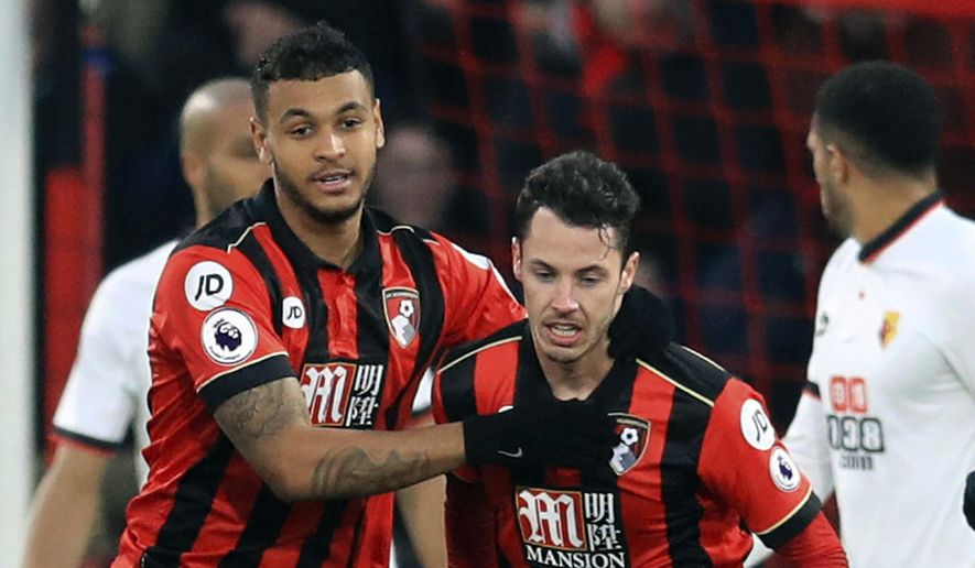 Bournemouth's Joshua King, left, celebrates scoring his side's first goal of the game with teammate Adam Smith during the English Premier League soccer match between Bournemouth and Watford, at the Vitality Stadium, in  Bournemouth, England,  Saturday Jan. 21, 2017. (Adam Davy/PA via AP)