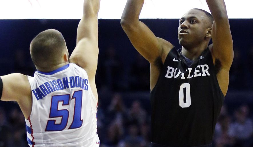 Butler guard Avery Woodson, right, shoots against DePaul guard Chris Harrison-Docks during the first half of an NCAA college basketball game, Saturday, Jan. 21, 2017, in Rosemont, Ill. (AP Photo/Nam Y. Huh)