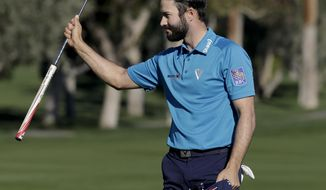 Adam Hadwin celebrates on the 18th hole after shooting a 59 to take the third round lead in the CareerBuilder Challenge golf tournament at La Quinta Country Club Saturday, Jan. 21, 2017, in La Quinta, Calif. (AP Photo/Chris Carlson)