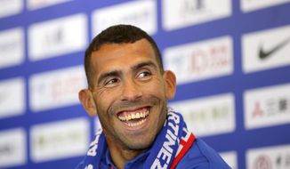 Argentine striker Carlos Tevez attends his first presser after joining Shanghai Shenhua in Shanghai, China Saturday Jan. 21, 2017. Shanghai Shenhua has recruited Carlos Tevez reportedly with a deal that made the Argentine the highest-paid soccer player in the world. (Chinatopix Via AP)
