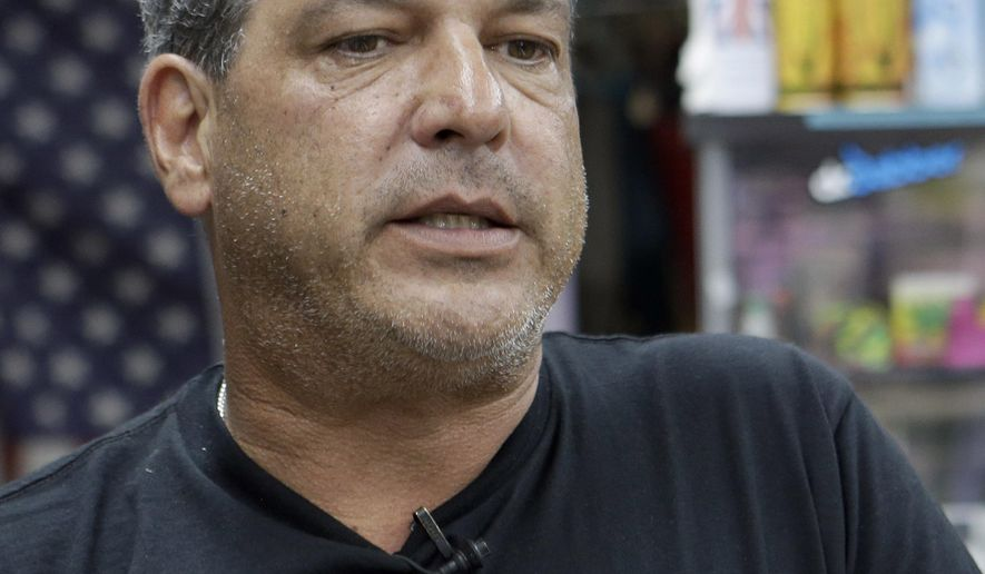 Jay Work talks to a reporter at his Grateful J's smoke shop, Thursday, Jan. 12, 2017, in Margate, Fla. High-end German glass water pipe maker Roor and its American licensee are filing lawsuits against smoke shops and mom-and-pop convenience stores in Florida, California and New York alleging that they are selling Roor counterfeits, violating its trademark.  (AP Photo/Alan Diaz)