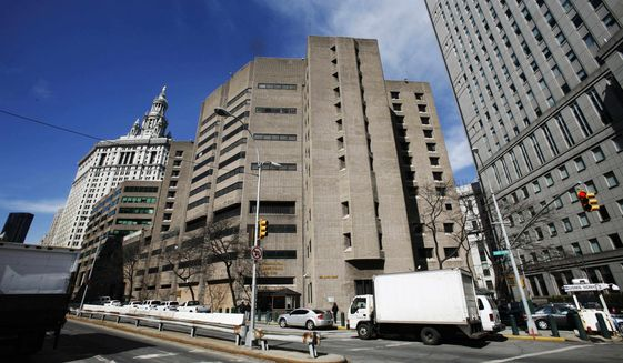 This March 12, 2009, file photo shows the Metropolitan Correctional Center in New York City. (AP Photo/Mark Lennihan, File)