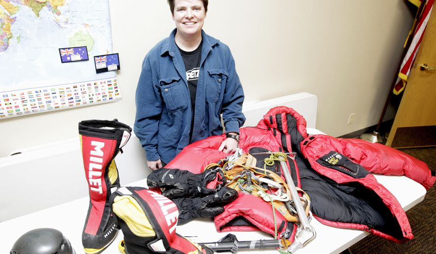 ADVANCE FOR USE SATURDAY, JAN. 21 - In this Monday, Jan. 9, 2017 photo, Jen Loeb poses with climbing gear at the Jesup Public Library in Jesup, Iowa. Last year Loeb, 40, became the first Iowa woman to summit Mount Everest, the world's tallest peak at 29,029 feet above sea level. (Tiffany Rushing/The Courier via AP)
