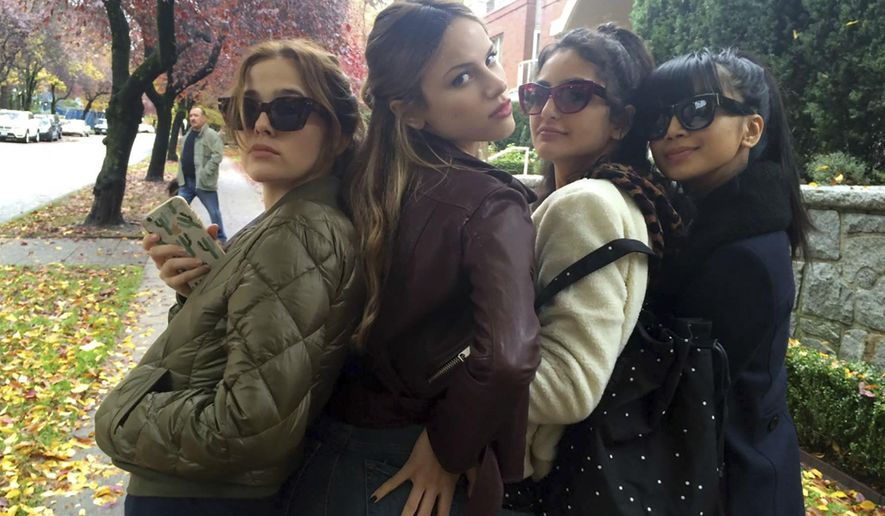 """This image released by the Sundance Institute shows, from left, Zoey Deutch, Halston Sage, Medalion Rahimi and Cynthy Wu in a scene from, """"Before I Fall,"""" a film by Ry Russo-Young. The film is an official selection of the Premieres program at the 2017 Sundance Film Festival. (Sundance Institute via AP)"""