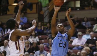 In this Nov. 11, 2016, photo, Citadel guard Kaelon Harris shoots a three point shot against the College of Charleston at TD Arena in Charleston, S.C. Never mind their records, Savannah State and the Citadel have the fastest-moving offenses in Division I basketball. Their mantra: rush the ball up the court and get off a shot, all the better if it's a 3-pointer.  (Michael Pronzato/The Post And Courier via AP)