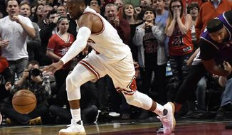 Chicago Bulls guard Dwyane Wade (3) steals the ball against the Sacramento Kings during the second half of an NBA basketball game in Chicago, Saturday, Jan. 21, 2017. (AP Photo/David Banks)