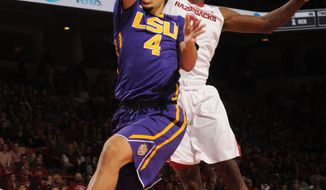 LSU guard Skylar Mays (4) reaches to score as he is fouled by Arkansas guard Jaylen Barford during the first half of an NCAA college basketball game Saturday, Jan. 21, 2017, in Fayetteville, Ark. (Andy Shupe/Northwest Arkansas Democrat-Gazette via AP)