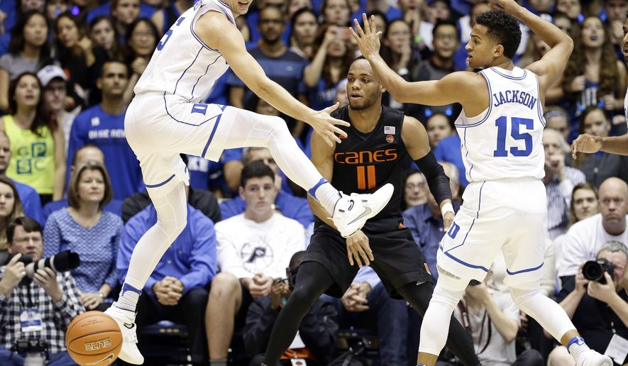 Duke's Luke Kennard, left, and Frank Jackson (15) guard Miami's Bruce Brown (11) during the first half of an NCAA college basketball game in Durham, N.C., Saturday, Jan. 21, 2017. (AP Photo/Gerry Broome)