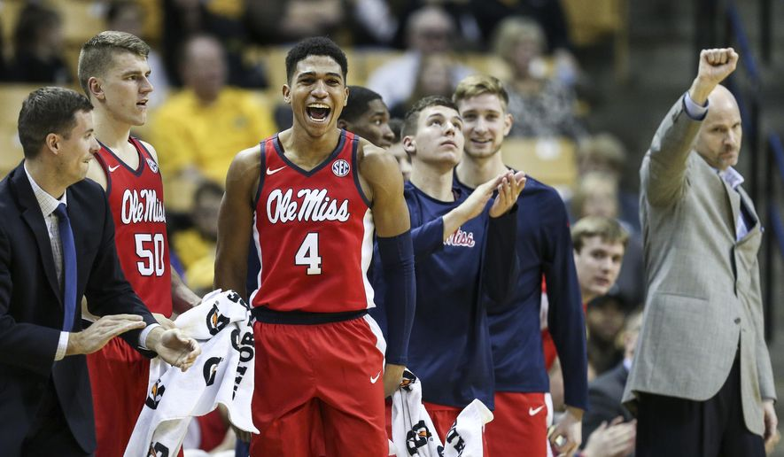 Ole Miss guard Breein Tyree (4) celebrates from the bench during the second half of an NCAA college basketball game against Missouri, Saturday, Jan. 21, 2017, in Columbia, Mo. (Timothy Tai/Columbia Daily Tribune via AP)
