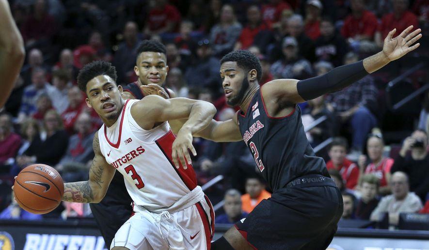 Rutgers guard Corey Sanders (3) looks to make a shot as Nebraska forward Jeriah Horne (2) defends during the first half of an NCAA college basketball game Saturday, Jan. 21, 2017, in Piscataway, N.J. (AP Photo/Mel Evans)