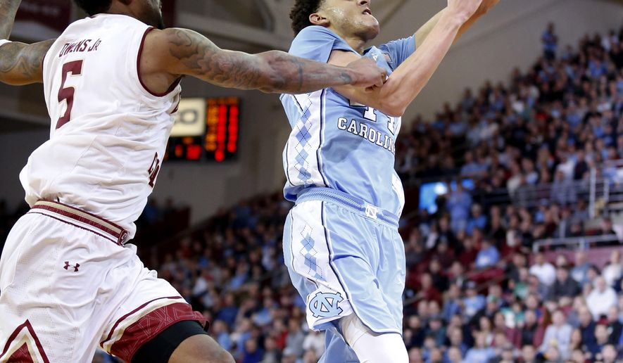 North Carolina forward Justin Jackson (44) drives to the basket ahead of Boston College forward Garland Owens (5) during the first half of an NCAA college basketball game in Boston, Saturday, Jan. 21, 2017. (AP Photo/Mary Schwalm)