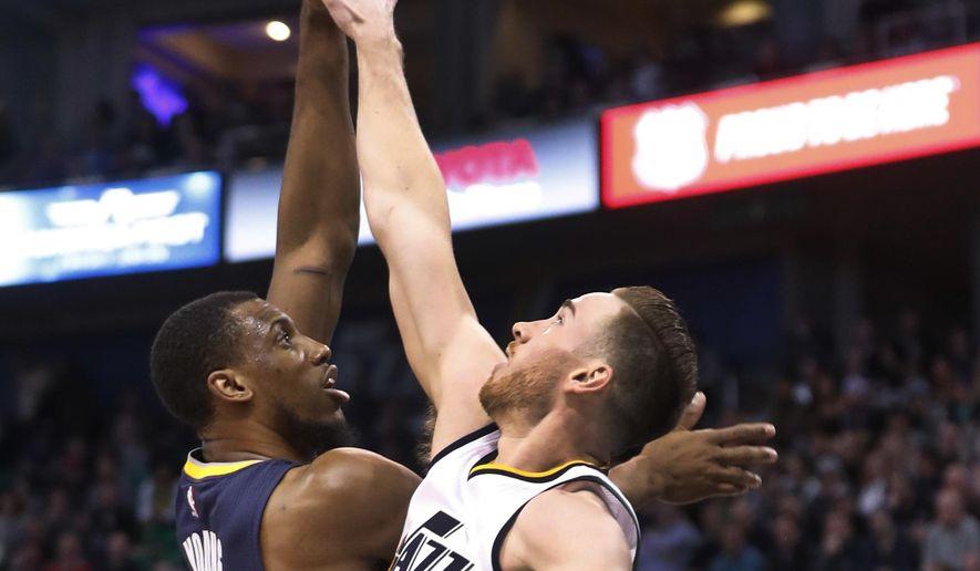 Utah Jazz forward Gordon Hayward (20) tries to block the shot of Indiana Pacers forward Thaddeus Young (21) during the first half of an NBA basketball game, Saturday, Jan. 21, 2017, in Salt Lake City. (AP Photo/George Frey)