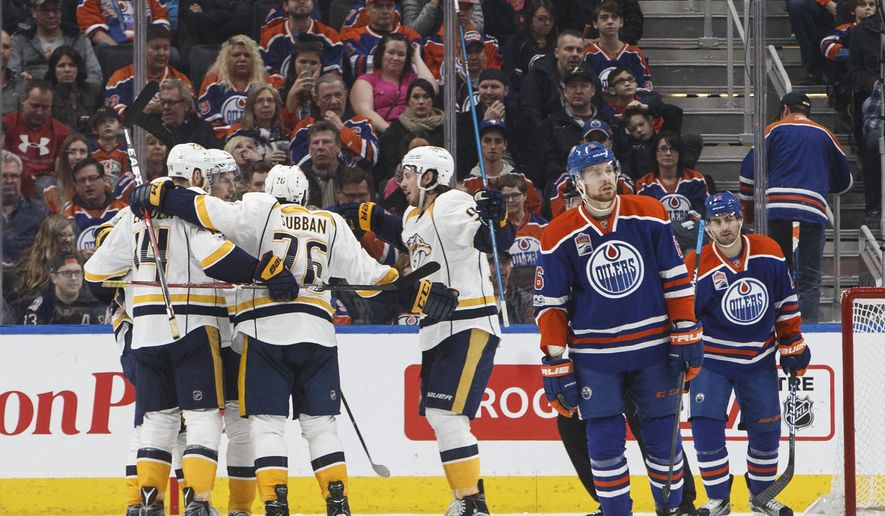 Nashville Predators players celebrate a goal against the Edmonton Oilers during the second period of an NHL hockey game, Friday, Jan. 20, 2017 in Calgary, Alberta. (Jason Franson/The Canadian Press via AP)