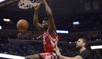 Houston Rockets center Clint Capela (15) dunks the ball against Memphis Grizzlies center Marc Gasol in the first half of an NBA basketball game Saturday, Jan. 21, 2017, in Memphis, Tenn. (AP Photo/Brandon Dill)