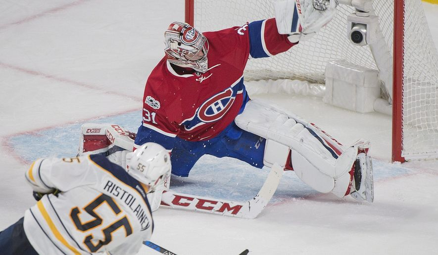 Montreal Canadiens goaltender Carey Price makes a save on Buffalo Sabres' Rasmus Ristolainen during third-period NHL hockey game action in Montreal, Saturday, Jan. 21, 2017. (Graham Hughes/The Canadian Press via AP)