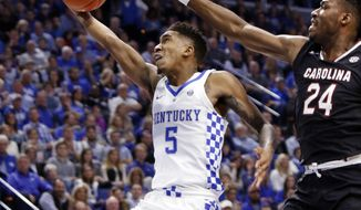 Kentucky's Malik Monk (5) shoots while defended by South Carolina's Sedee Keita (24) during the first half of an NCAA college basketball game, Saturday, Jan. 21, 2017, in Lexington, Ky. (AP Photo/James Crisp)