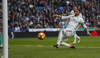 Real Madrid's Sergio Ramos scores a goal during a Spanish La Liga soccer match between Real Madrid and Malaga at the Santiago Bernabeu stadium in Madrid, Saturday, Jan. 21, 2017. (AP Photo/Francisco Seco)