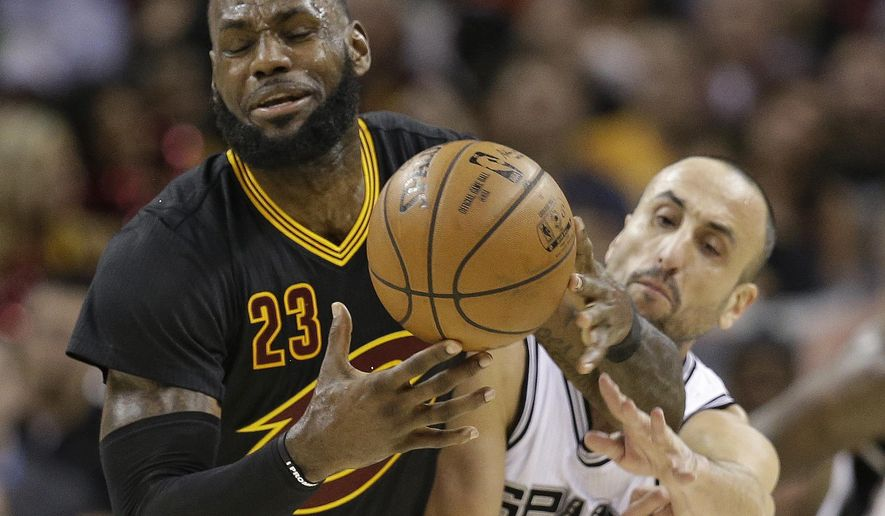 San Antonio Spurs' Manu Ginobili, back, from Argentina, knocks the ball loose from Cleveland Cavaliers' LeBron James in the first half of an NBA basketball game, Saturday, Jan. 21, 2017, in Cleveland. (AP Photo/Tony Dejak)