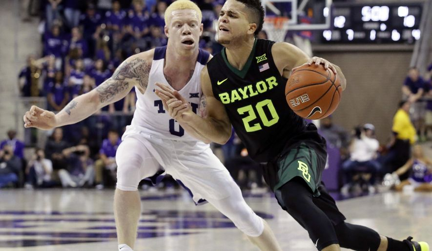 Baylor guard Manu Lecomte (20) drives against TCU guard Jaylen Fisher (0) during the first half of an NCAA college basketball game in Fort Worth, Texas, Saturday, Jan. 21, 2017. (AP Photo/LM Otero)