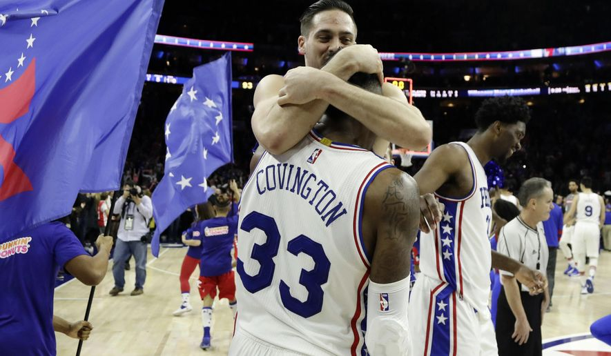 Philadelphia 76ers' T.J. McConnell, top, celebrates with Robert Covington after the 76ers' won an NBA basketball game against the Portland Trail Blazers, Friday, Jan. 20, 2017, in Philadelphia. Philadelphia won 93-92. (AP Photo/Matt Slocum)