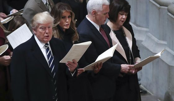 From left, President Donald Trump, first lady Melania Trump, Vice President Mike Pence and his wife Karen, sing together during a National Prayer Service at the National Cathedral, in Washington, Saturday, Jan. 21, 2017. (AP Photo/Manuel Balce Ceneta)
