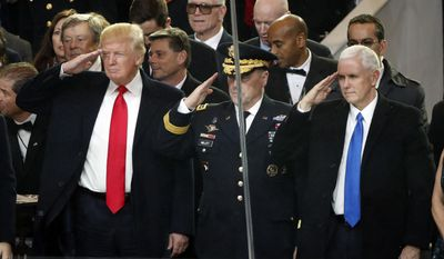 President Donald Trump salutes with Army Chief of Staff General Mark A. Milley and Vice President Mike Pence during the 58th Presidential Inauguration parade for President Donald Trump in Washington. Friday, Jan. 20, 2017 (AP Photo/Pablo Martinez Monsivais)