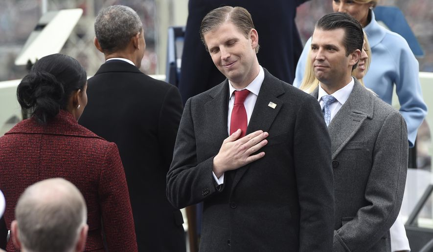 Eric Trump, center, and Donald Trump, Jr., attend the presidential inauguration of their father Donald Trump on Capitol Hill in Washington, Friday, Jan. 20, 2017. (Saul Loeb/Pool Photo via AP)