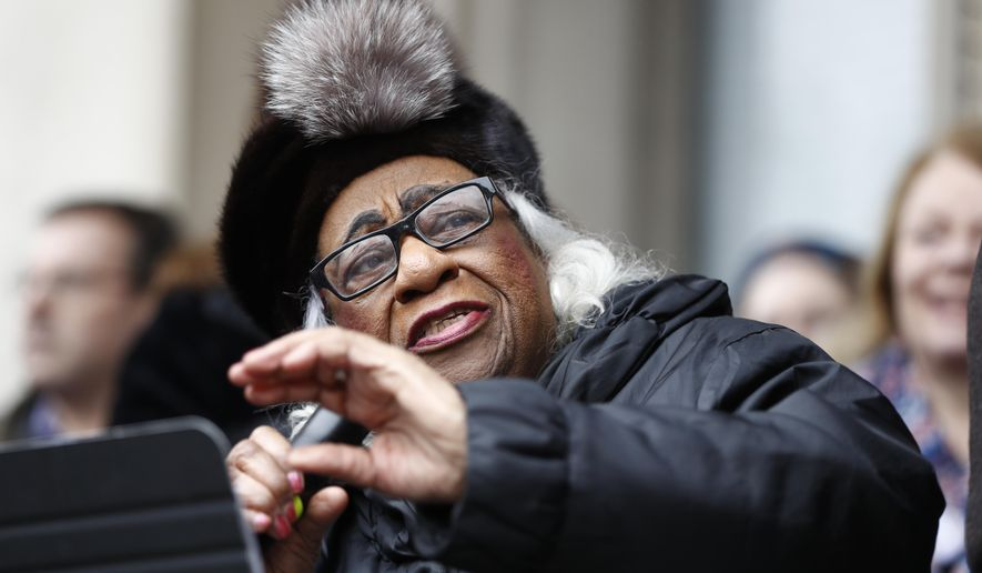 Civil rights activist Edith Savage-Jennings delivers remarks during a rally in support of the national Women's March on Washington during a gathering on the steps of the New Jersey Statehouse, Saturday, Jan. 21, 2017, in Trenton, N.J. The march was held in in conjunction with with similar events taking place around the nation following the inauguration of President Donald Trump. (AP Photo/Julio Cortez)