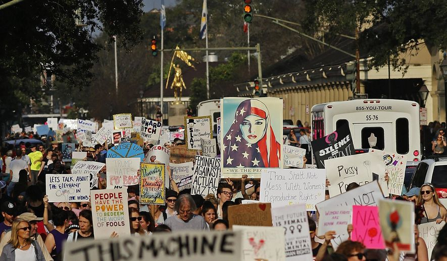 Several thousand people make their way down Decatur Street while taking part in a Women's March in New Orleans, Saturday, Jan. 21, 2017. (AP Photo/Max Becherer) **FILE**
