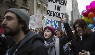 Demonstrators march up 5th Avenue during a women's march, Saturday, Jan. 21, 2017, in New York. The march is being held in solidarity with similar events taking place in Washington and around the nation. (AP Photo/Mary Altaffer)