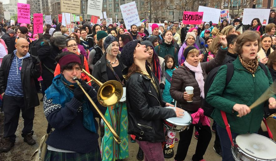 Protesters gather for the Women's March on Philadelphia a day after Republican Donald Trump's inauguration as president, Saturday, Jan. 21, 2017 in Philadelphia.  The march is being held in solidarity with similar events taking place in Washington and around the nation.  (AP Photo/Jacqueline Larma)