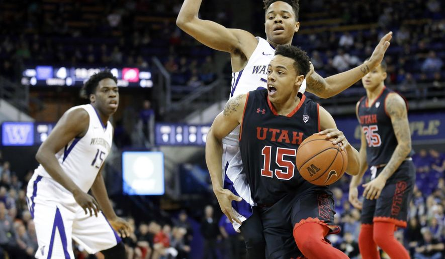 Utah guard guard Lorenzo Bonam (15) drives around Washington guard Markelle Fultz, center, during the first half of an NCAA college basketball game, Saturday, Jan. 21, 2017, in Seattle. (AP Photo/Ted S. Warren)