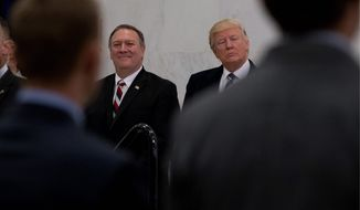President Trump and CIA Director-designate Mike Pompeo visited the CIA on Saturday. Mr. Pompeo was still awaiting confirmation by the Senate. (Associated Press)
